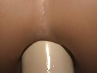 Petite brunette Kream squirting from a brutal dildo in her pussy and ass